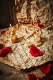Music sheets with rose petals Stock Image