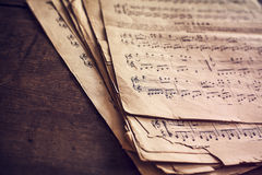 Music sheets on wooden background Royalty Free Stock Photos
