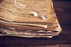 Music sheets on wooden background Royalty Free Stock Image