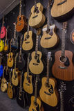 Music Shop Guitars Dozens Royalty Free Stock Images
