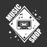 Music shop promotional logotype with retro cassette and notes. Music shop promotional black and white logotype with retro cassette inside rhombus, notes around Royalty Free Stock Photos