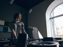 Music shop. Thoughtful girl chooses vinyl records. Calm atmospheric place, creative mood Stock Images