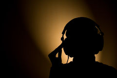 Music silhouette. Silhouette of a woman with headphones on her head Stock Images