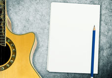 Music Song Writing with blank notebook guitar. Blank Music Song Writing with blank notebook and guitar Royalty Free Stock Images