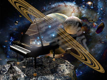 Music and space. A piano on an asteroid into space, creates music that seems to create new stars Stock Photography