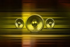 Music speakers with gold light streaks Royalty Free Stock Photo