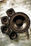 Music - speakers and notes. A loudspeaker, speaker, or speaker system on old notes Stock Image