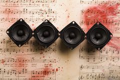 Music - speakers and notes. A loudspeaker, speaker, or speaker system on old notes Stock Photo