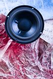 Music - speakers and notes. A loudspeaker, speaker, or speaker system on old notes Stock Photos