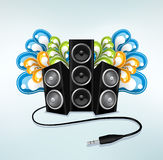 Music speakers in party mode. Moder background with three audio bass speakers, audio jack and colorful glossy design elemets Royalty Free Stock Photos