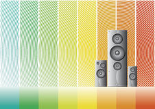 Music speakers on a rainbow lined background. Vector illustrations of three shaded speakers on a colorful rainbow background Royalty Free Stock Photo