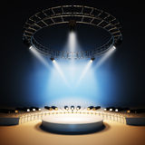 Music stage illuminated by spotlights. Royalty Free Stock Image