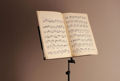 Music stand on brown background Stock Photo