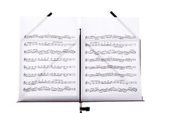 Music stand with melody sheets Royalty Free Stock Photo