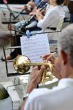 Music stand with notes and trumpet Stock Images