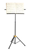 Music stand with piano notes isolated Stock Photos