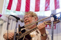 A man plays the guitar at the Iowa State Fair - De. A man plays the guitar at the Iowa State Fair royalty free stock photography