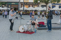 Music on the street. Music Group 3 Kings plays music on the main market in Krakow , Poland. Europe Royalty Free Stock Photography