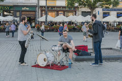 Music on the street. Music Group 3 Kings plays music on the main market in Krakow , Poland. Europe Stock Images