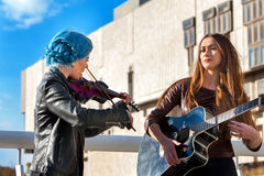 Music street performers with girl violinist. Autumn mood. Stock Photography