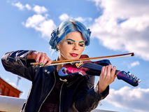 Music street performers with girl violinist Stock Images