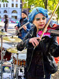 Music street performers with girl violinist. Foreground on autumn outdoor Royalty Free Stock Image