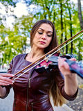 Music street performers with girl violinist Royalty Free Stock Images