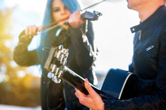 Music street performers with girl violinist. Music in sun rays. Royalty Free Stock Images