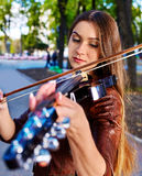 Music street performers with girl violinist. Music street performers girl violinist  playing  in park Stock Photography
