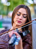 Music street performers with girl violinist . Stock Photo