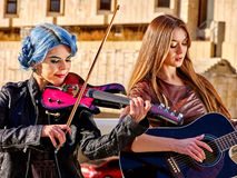 Music street performers with girl violinist Royalty Free Stock Image