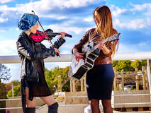 Music street performers with girl violinist. Royalty Free Stock Photography
