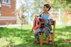 Music student playing the guitar Royalty Free Stock Image