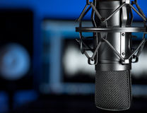 Music studio. Microphone in the  music recording studio , focus on the microphone, for music production,audio,entertainment themes Royalty Free Stock Photos