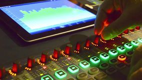 Music studio audio mixer with digital VU meter display stock video