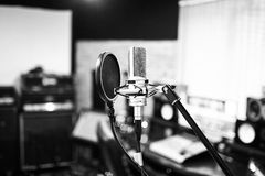 Music studio. Condenser microphone. BW. Silver condenser microphone with pop filter and anti-vibration mount. Music studio. Professional sound and voice royalty free stock photo