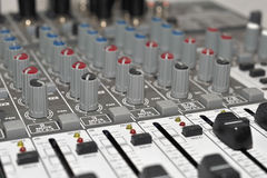 Music Studio Mixer. An abstract view of the knobs and sliders of an mixer in a music studio Royalty Free Stock Images
