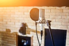 Music studio. Silver condenser microphone with pop filter. Silver condenser microphone with pop filter and anti-vibration mount. Music studio. Professional sound royalty free stock images