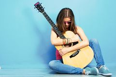 Music style beautiful girl portrait. Woman sitting on a floor stock images