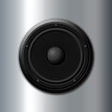 Music symbol. Black speaker over metal background stock photos