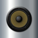 Music symbol. Yellow speaker over metal background royalty free stock photos
