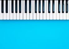 Music Synthesizer Piano Keyboard keys on blue. Copy space stock photography