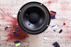 Music system. A loudspeaker, speaker, or speaker system on old notes Stock Photos