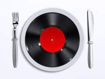 Music taste. A dish with vinyl record Stock Images