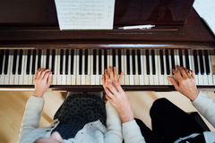 Music teacher with the pupil at   lesson piano, Royalty Free Stock Photos