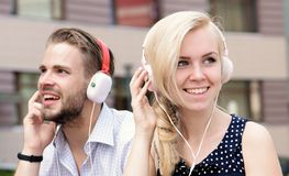 Music and technologies concept. Couple in love listening music in headphones. stock photo