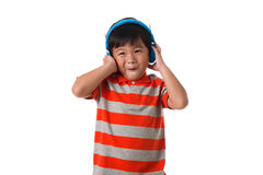 Music and technology concept.Asian little boy with headphone. Music and technology concept.Cute asian little boy with headphone on white background.Emotions Stock Photography