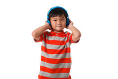 Music and technology concept.Asian little boy with headphone.Isolated stock photography
