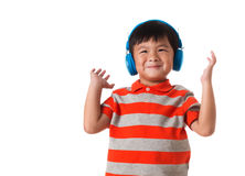 Music and technology concept.Asian little boy with headphone.Isolated. Music and technology concept.Asian little boy with headphone on white background.Copyspace Royalty Free Stock Photos