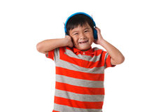 Music and technology concept.Asian little boy with headphone. Music and technology concept.Asian little boy with headphone on white background Stock Photography